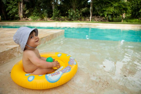 Happy baby in the pool at Iguana Lodge