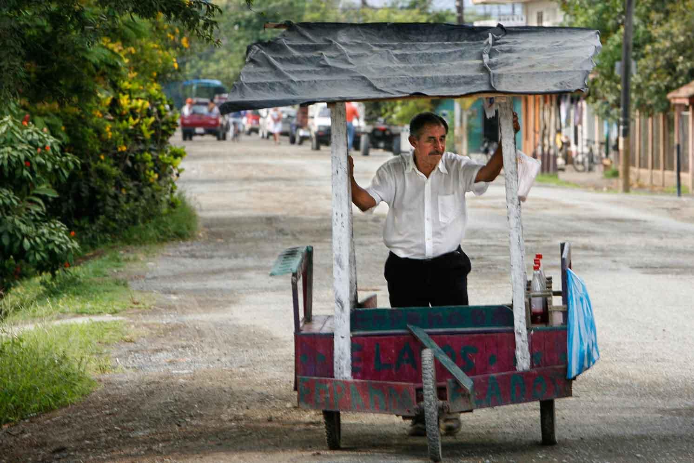 Man selling food from cart in Puerto Jimenez